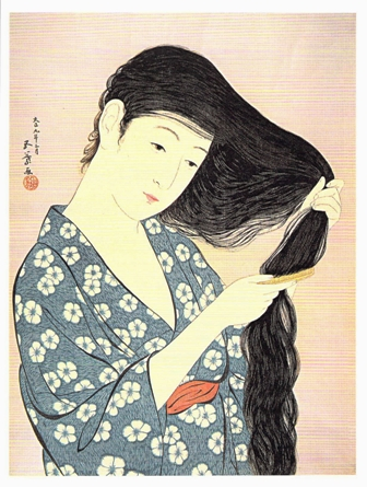 髪梳ける女