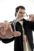 3806933-hair-stylist-holding-a-pair-of-scissors-against-white-background.jpg