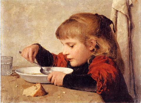 スープを飲む少女