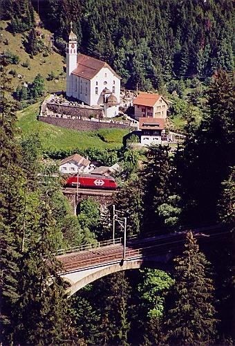 Wassen_Church_behind_UpperMiddleMeienreussBridges_ofGotthardbahn_fromRoad_toSustenPass.jpg